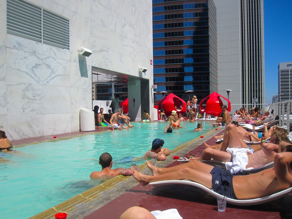 Guests Lounging by the pool at the standard downtown los angeles.