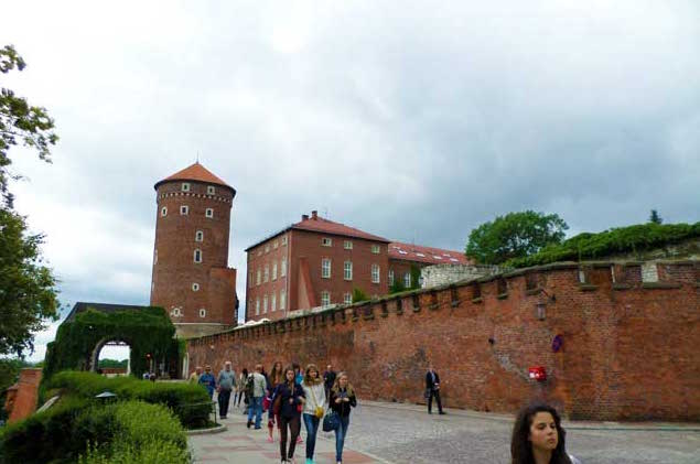 Tourists Leaving The Wawel Castle In Krakow Poland